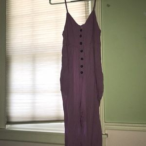 Purple flowy jumpsuit with button front